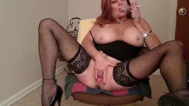 Redhead milf smokin 120s and masturbating 1