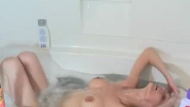 Milf shaving her nude body in the washroom