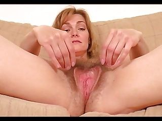 Curly golden-haired milf