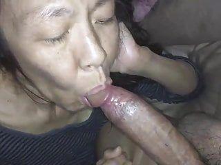 Oriental milf engulfing a white schlong
