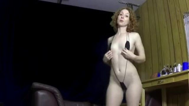 Sexy hot redhead milf wears a small string bikini belt shows her large booty