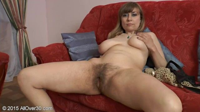 Older lady shows her unshaved snatch