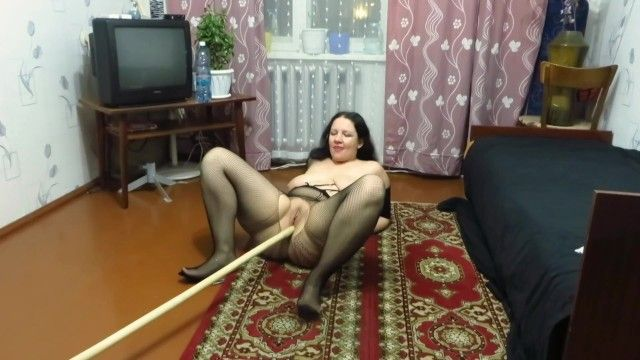 Aged angel masturbating her bawdy cleft with a stick